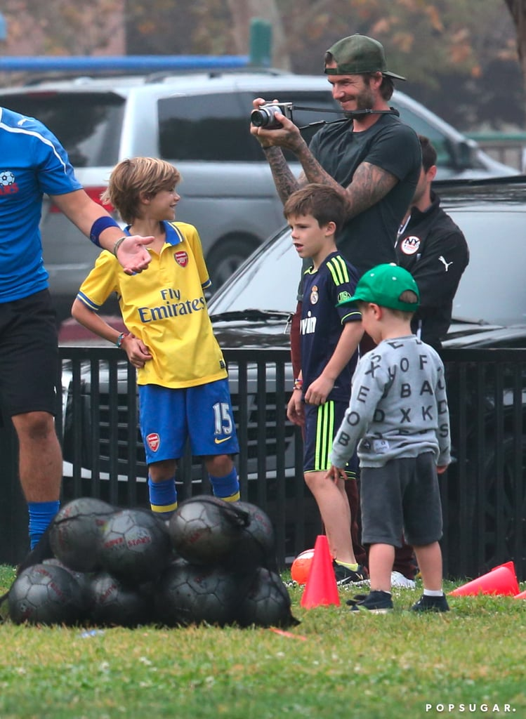 David Beckham was a proud dad, taking pictures of his daughter, Harper, when she played soccer in LA.