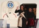 First Lady Michelle Obama gave a wave when the group arrived in China.