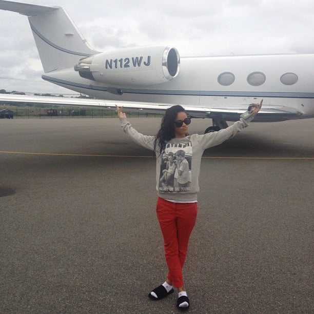 Rihanna posed near a private jet on her way home. Source: Instagram user badgalriri