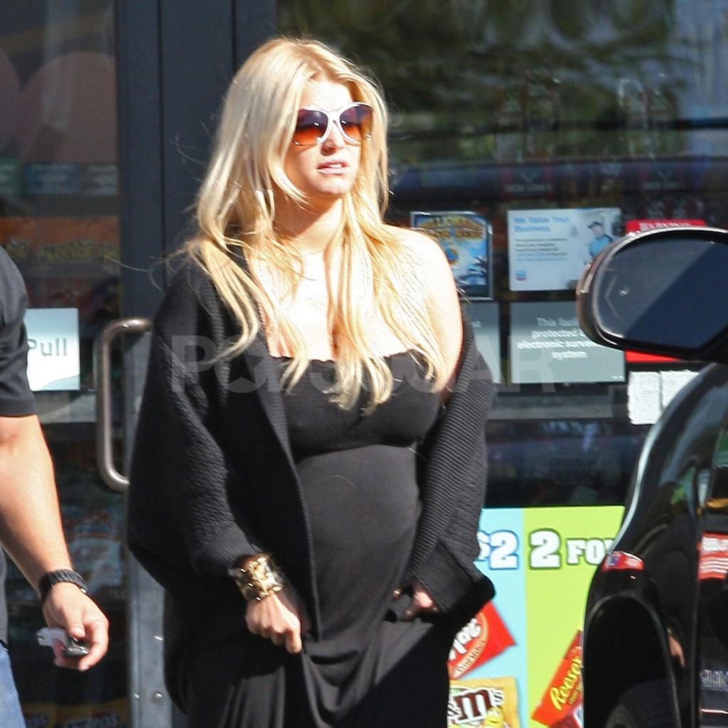 Jessica Simpson out in LA in a black dress.