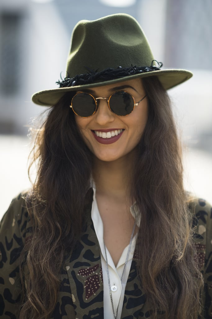 Dana Suchow's sweet chapeau and sleek sunglasses got a heightened look with a swipe of ruddy-brown lipstick. Source: Le 21ème | Adam Katz Sinding