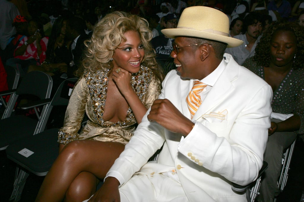 Decked out in gold and white, Jay-Z and Beyoncé sat side by side during the June 2004 MTV Video Music Awards.