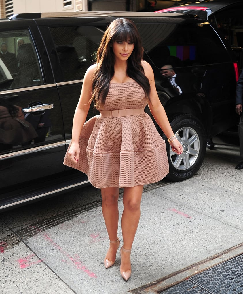 Kim Kardashian wore a flirty pink dress.