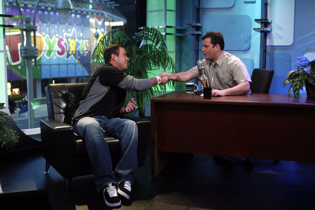 """Jimmy Kimmel sat in a """"practice"""" late-night desk to interview Carson Daly on TRL in 2003."""