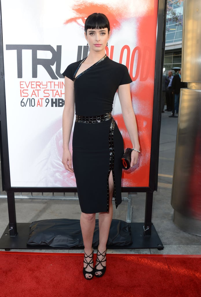 Krysten Ritter showed off her curves in a black, belted dress.