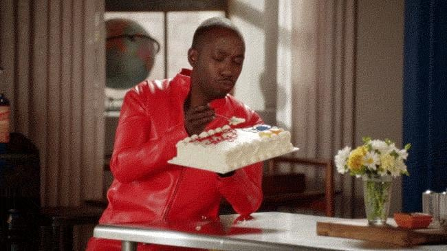 This birthday cake moment is priceless.