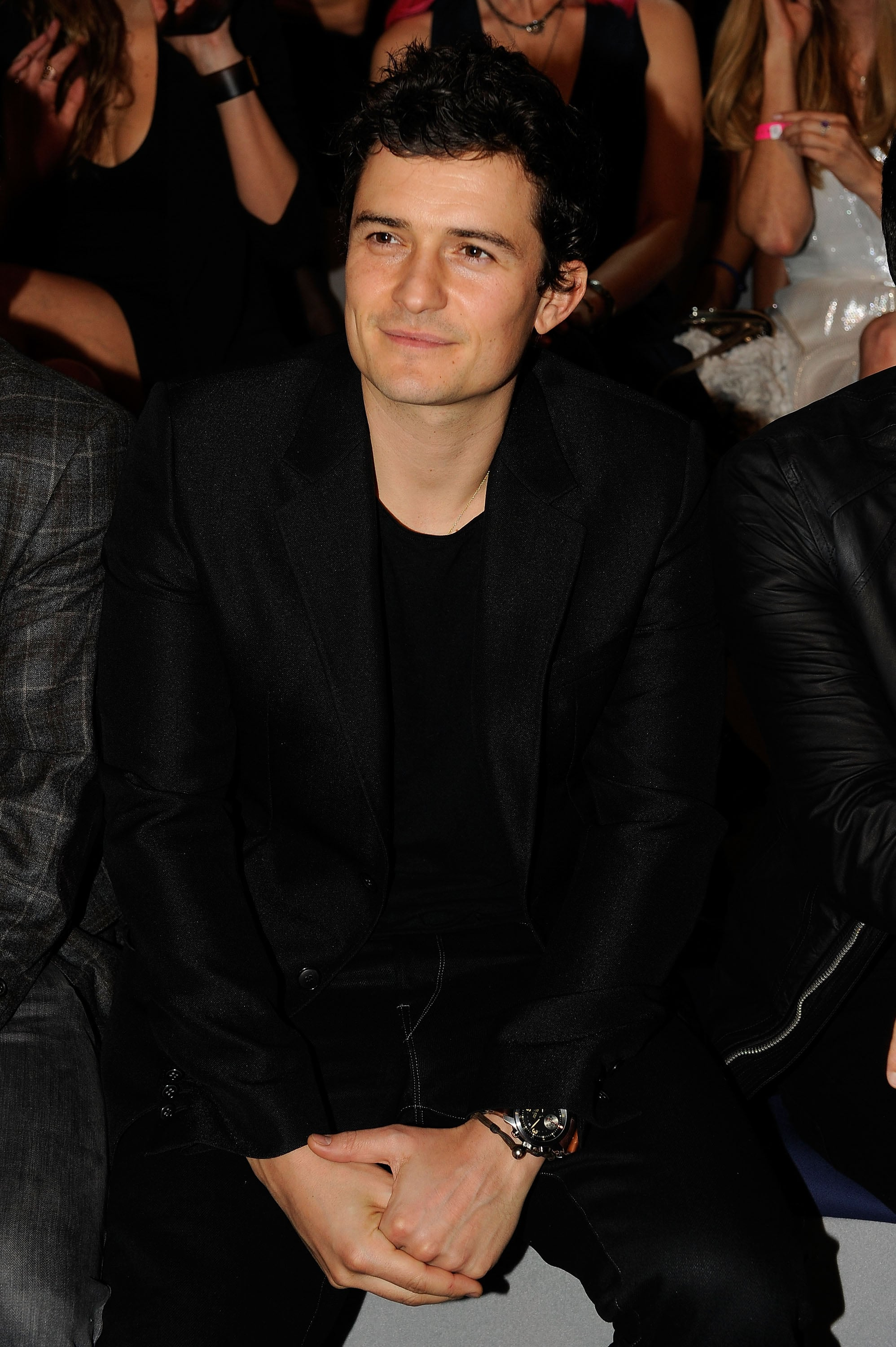 Orlando Bloom watched his then-wife Miranda Kerr in 2011 from the front row.