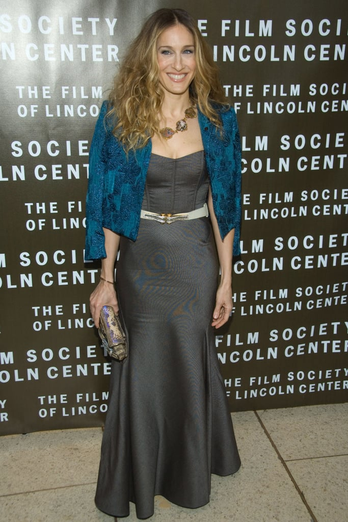 Parker swapped her signature minis for a charcoal trumpet-skirt Peter Soronen gown, lavish teal cropped jacket, and gold-trimmed gemstone necklace in NYC.