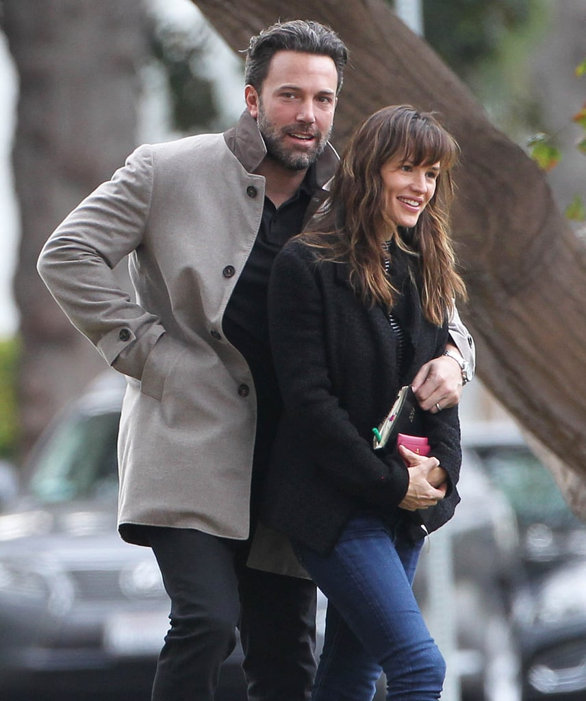 Ben cuddled up to Jen as they took a walk in LA in December 2014.