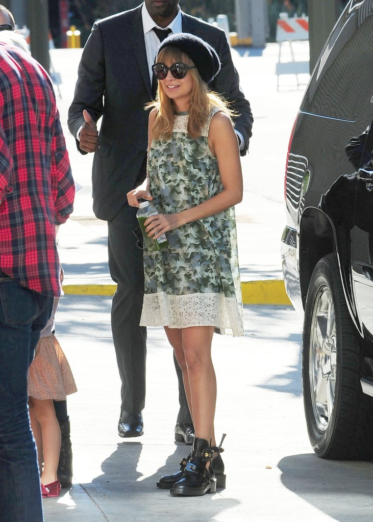 Nicole Richie wore a floral dress and black cap.