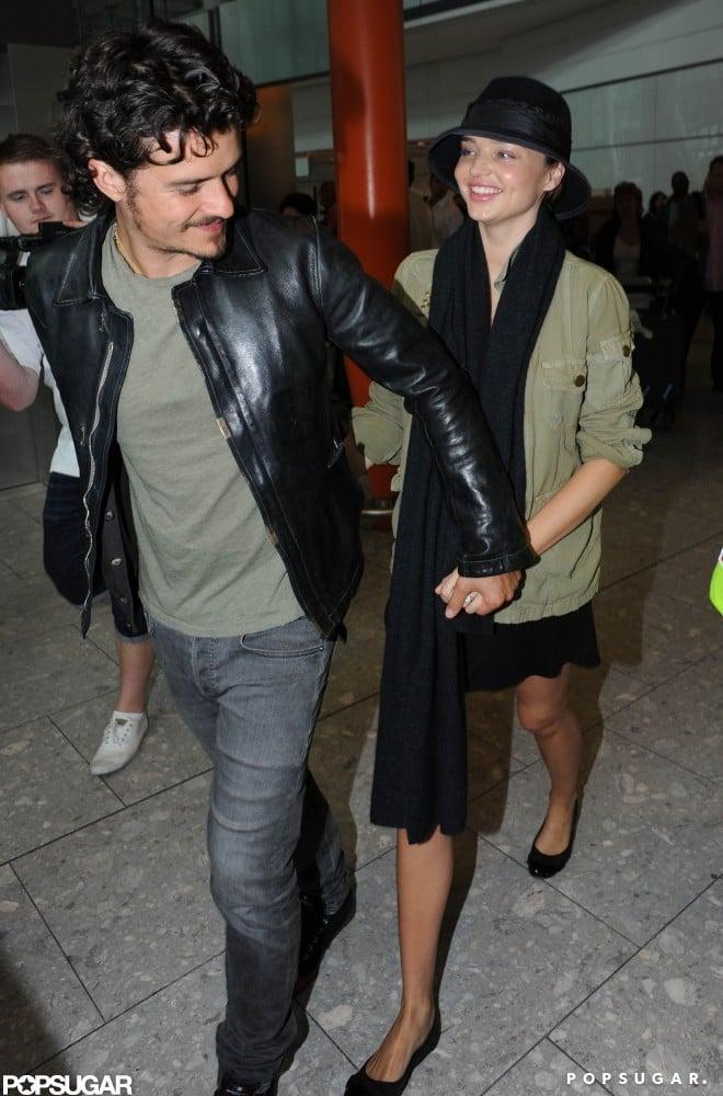 Orlando Bloom and his pregnant wife, Miranda Kerr, held hands leaving LAX in September 2010.