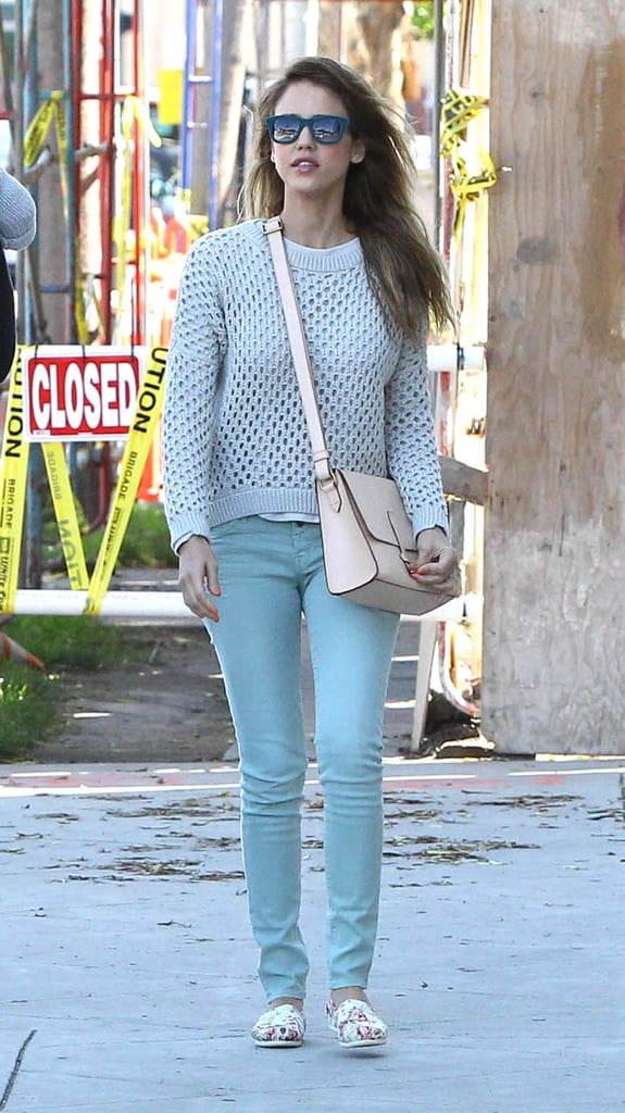 While running errands in LA, Jessica took pastels to new heights with baby blue denim, a crochet Aqua sweater, and a nude IIIBeCa by Joy Gryson messenger bag.