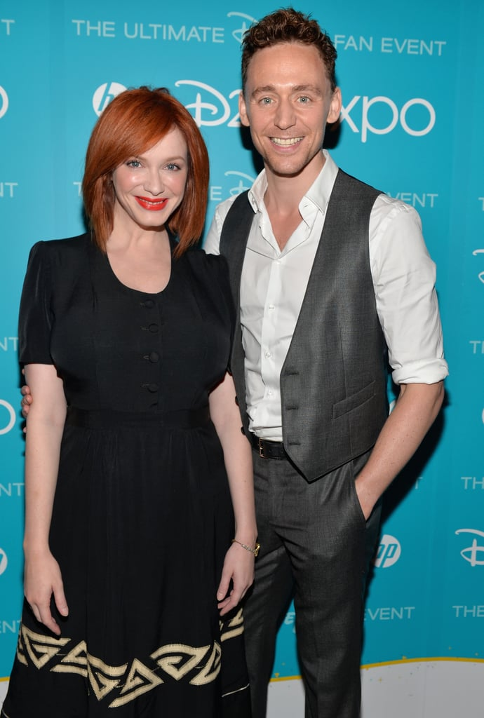 Christina Hendricks flashed a smile alongside Tom Hiddleston at the event.