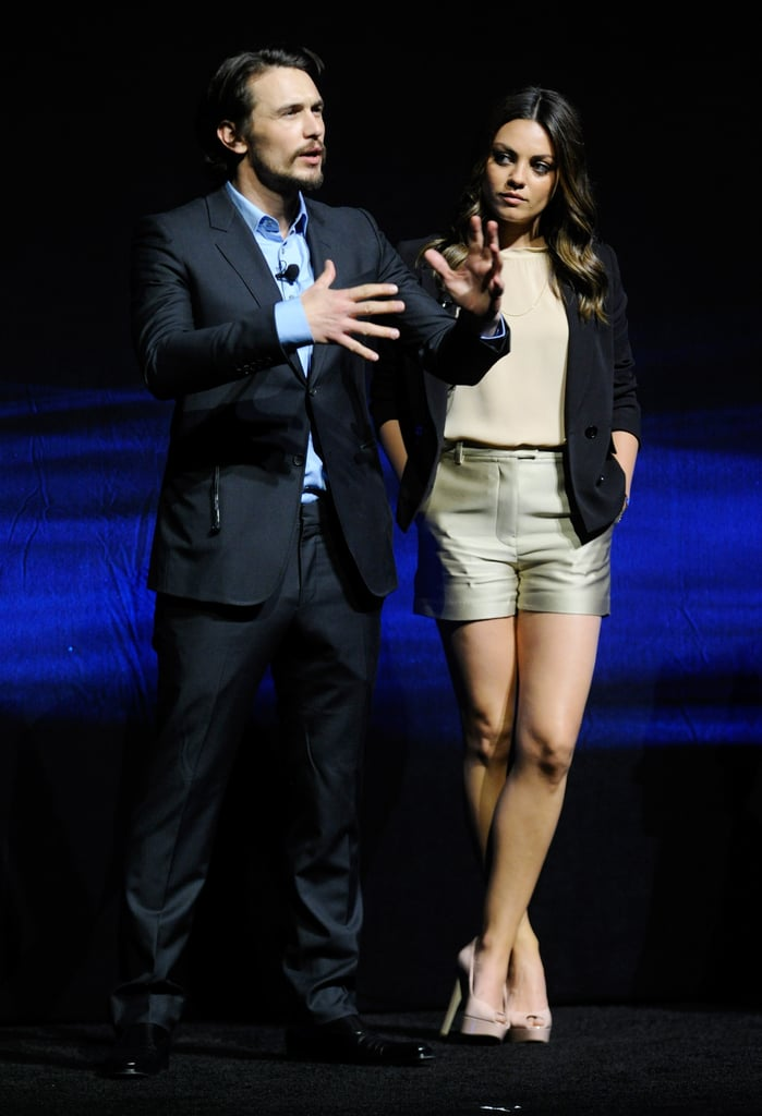 Mila Kunis shared the stage with James Franco at CinemaCon in Las Vegas.