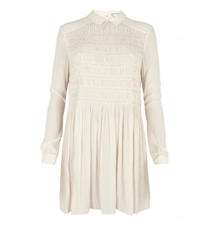 With black tights and booties, this AllSaints Smock Dress  ($225) will look even sweeter.