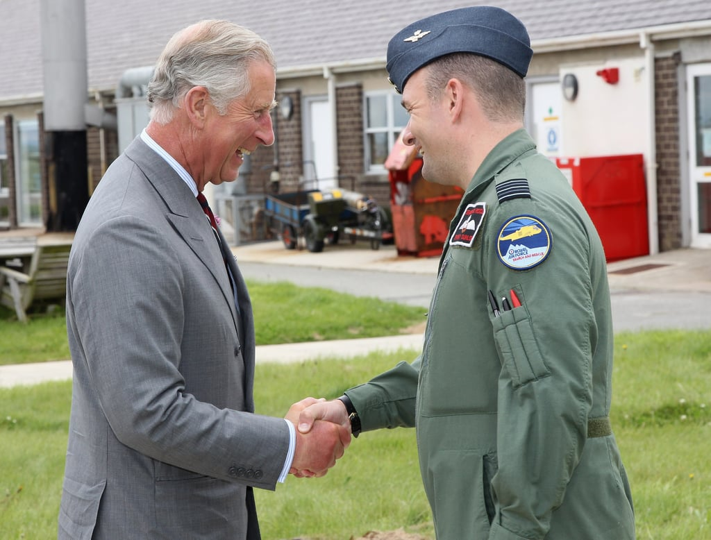 Prince Charles greeted someone on the base.