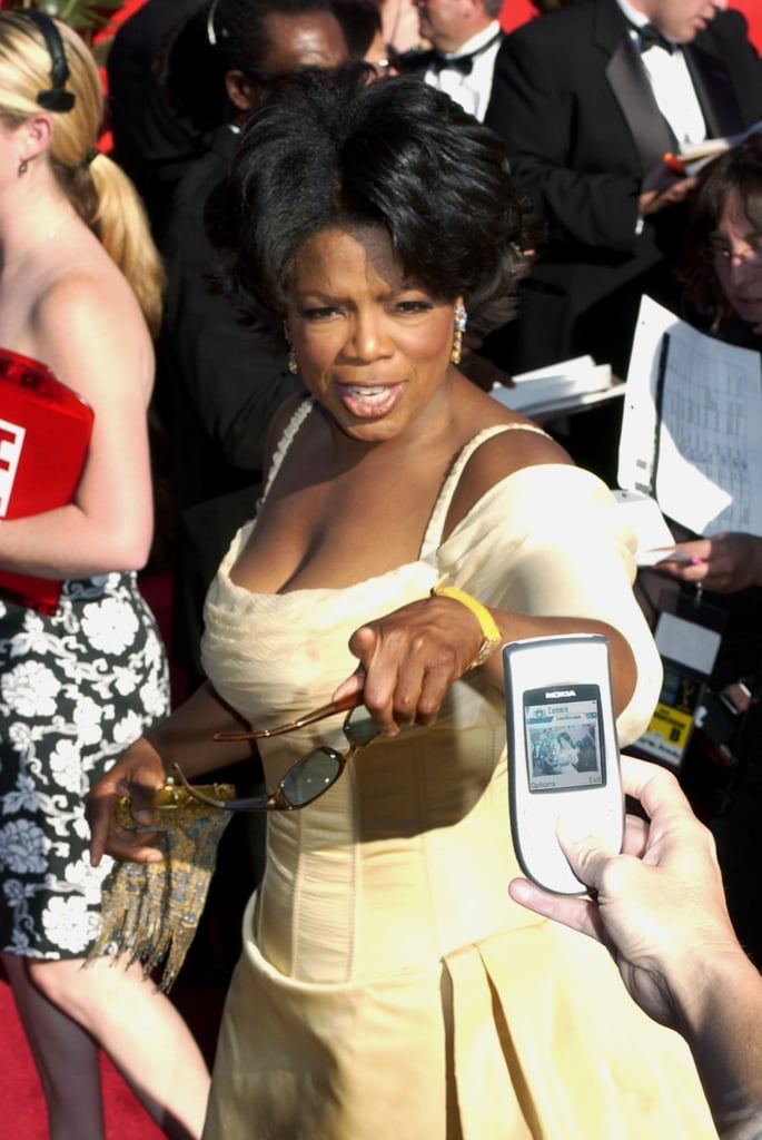 She pointed to cameras while walking the carpet for the 2002 Primetime Emmy Awards.