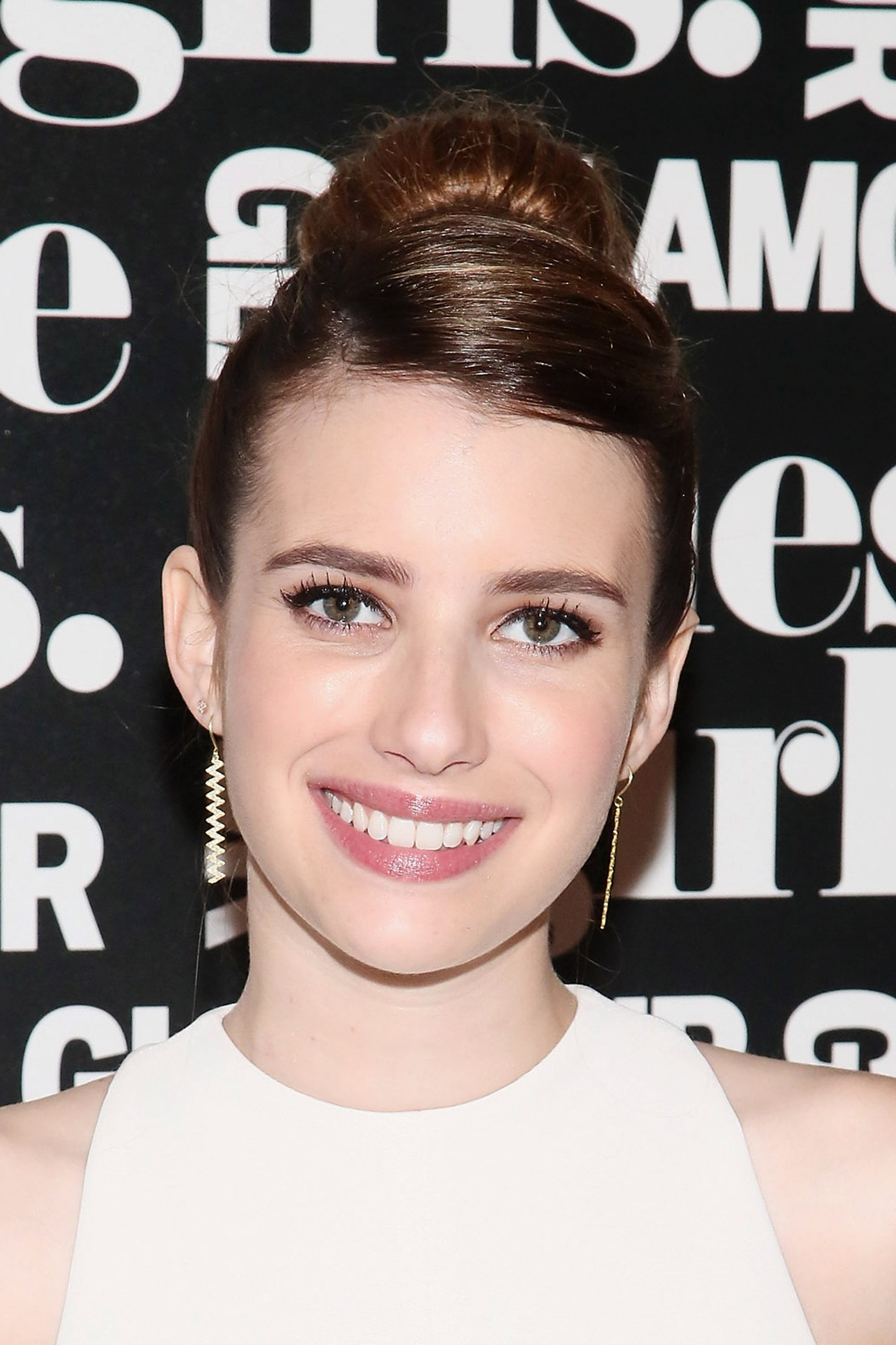 Don't want to let your fringe hang? Take note of Emma Roberts's style and sweep your bangs to the side with a part.