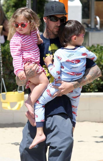 Travis Barker toted his tots around the playground.