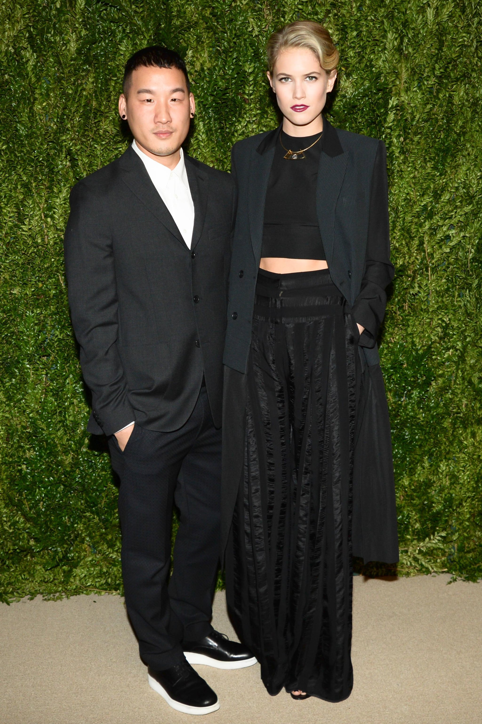 Cody Horn, with designer Richard Chai, wearing a look from the designer's Spring 2014 collection and jewelry from Yael Sonia.