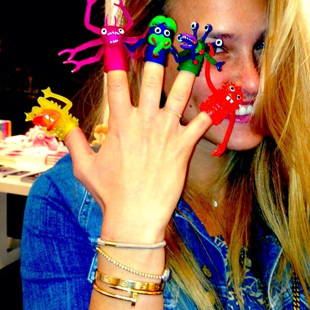 Bar Refaeli added some finger puppets to her arm party look. Source: Instagram user barrefaeli
