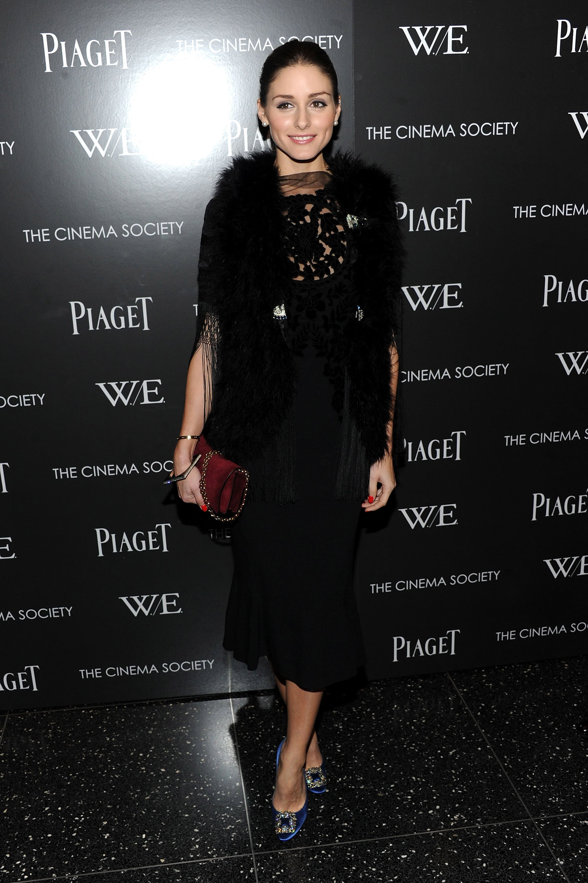 Olivia Palermo mixed fur and delicate sheer fabric for a chic evening look at the Cinema Society and Piaget film screening.