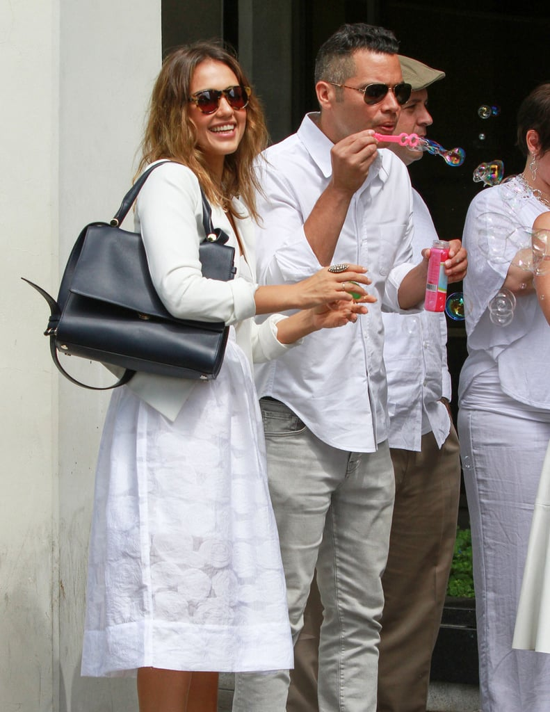 Jessica Alba and Cash Warren kept things playful at a friend's wedding in LA back in June 2014.