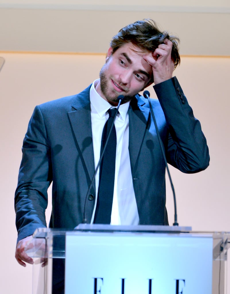 Robert couldn't help reaching for his man while delivering a speech at Elle's Women in Hollywood event in LA in October 2012.