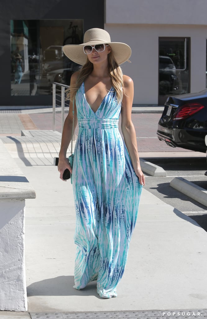 Paris Hilton kicked off her weekend in a maxi dress with a plunging neckline in Malibu, CA, on Friday.