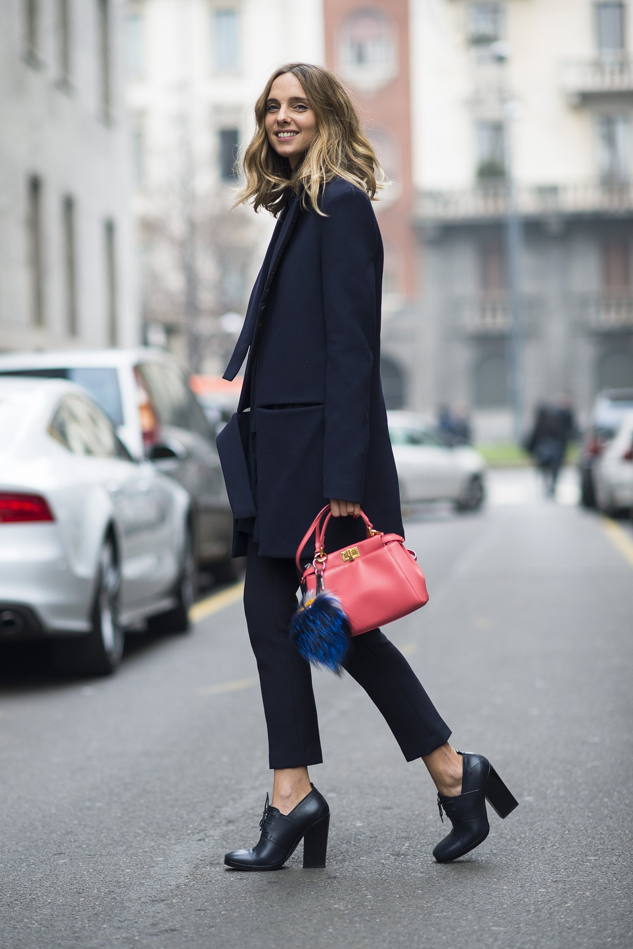 A bright bag and furry Fendi charm gave this menswear-inspired look a girl's touch.  Source: Le 21ème   Adam Katz Sinding