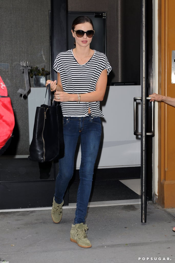 Miranda Kerr wore her olive-green Isabel Marant sneakers with a striped tee and dark skinny jeans during a day out in NYC.