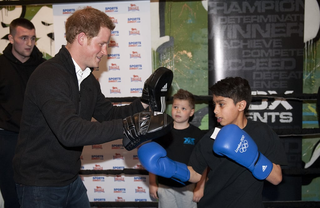 Prince Harry threw on a pair of boxing gloves at the KK Boxing Club in Nottingham, England.