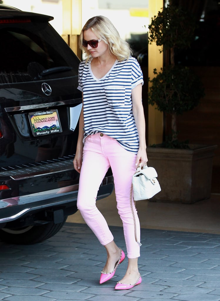 "In January 2014, Diane Kruger made Parisian pink a ""thing,"" styling her striped tee with light pink ankle-crop denim, studded Valentino flats, and a mini white Chanel handbag. Where to Wear: Game night with girlfriends."