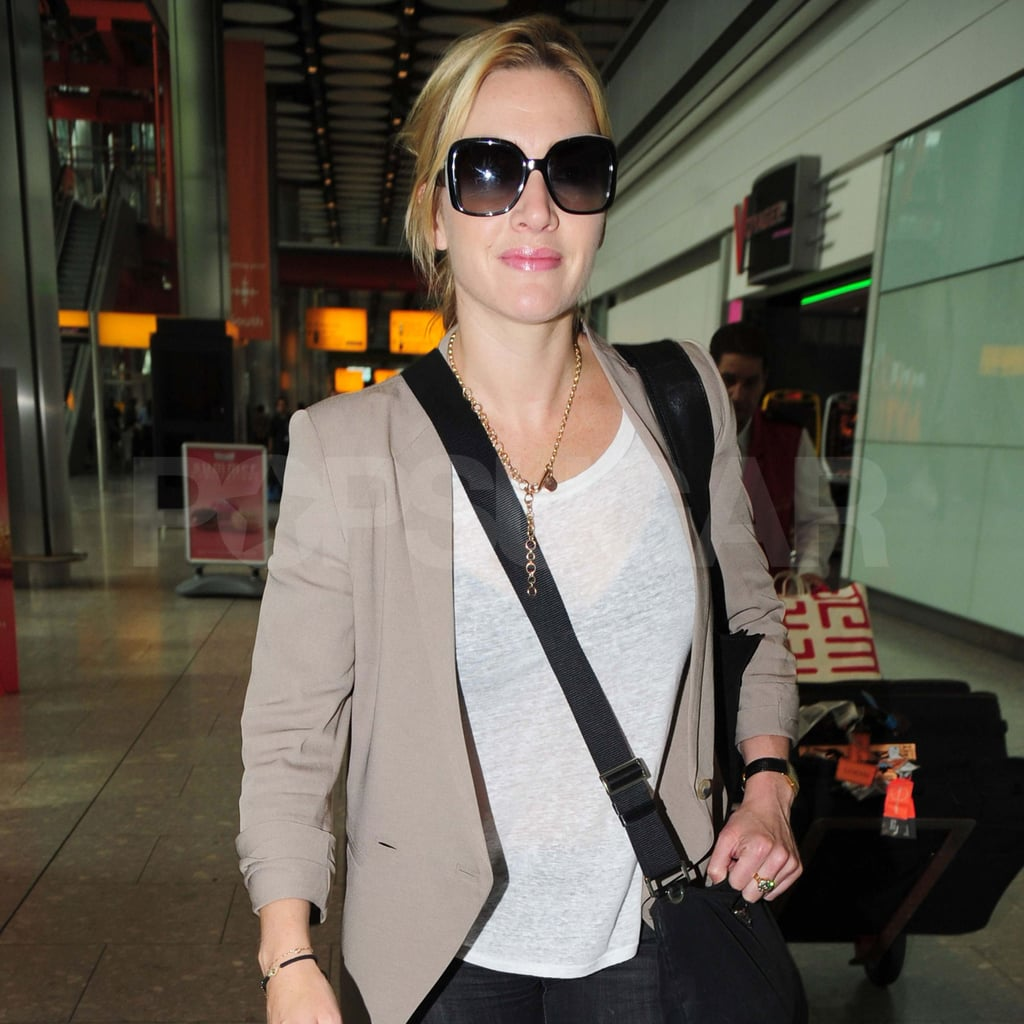 Kate Winslet in tan jacket at Heathrow.