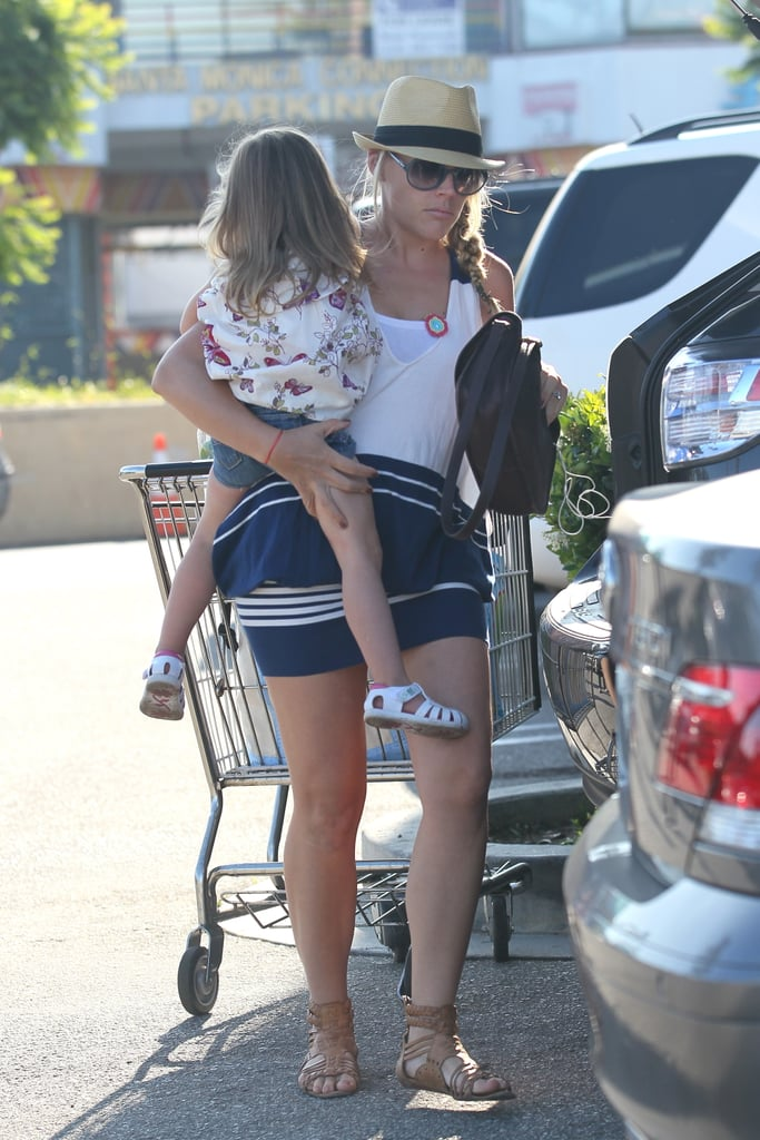 Busy Philipps carried Birdie out of Whole Foods.
