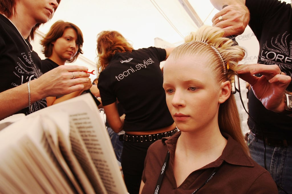 A model kept her eyes on her page-turner during Melbourne's Fashion Week in 2006.