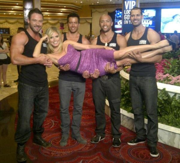 Heidi Klum got a lift from some very buff guys while promoting Clash of the Commercials.  Source: Twitter user heidiklum