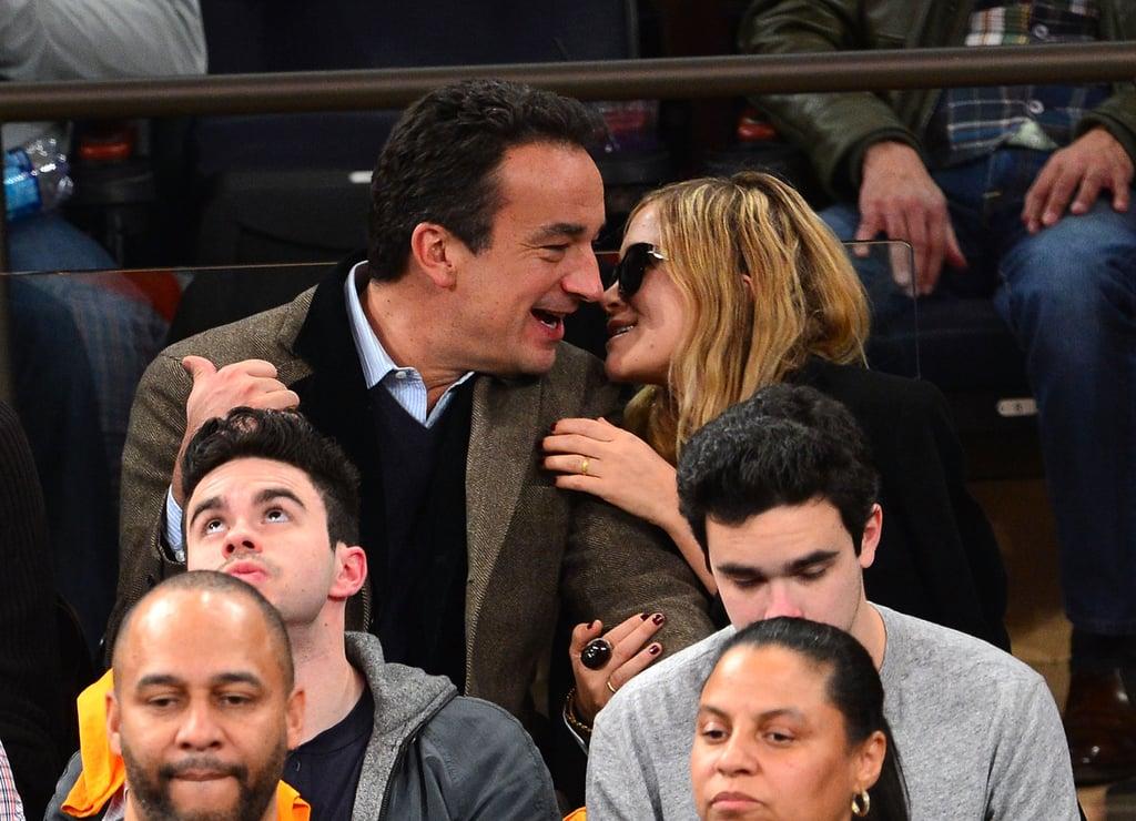 Mary-Kate Olsen snuggled with boyfriend Olivier Sarkozy.