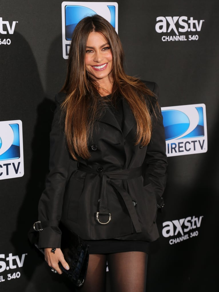 Sofia Vergara covered up on the carpet before heading into the Super Saturday Night event during Super Bowl Weekend 2013.