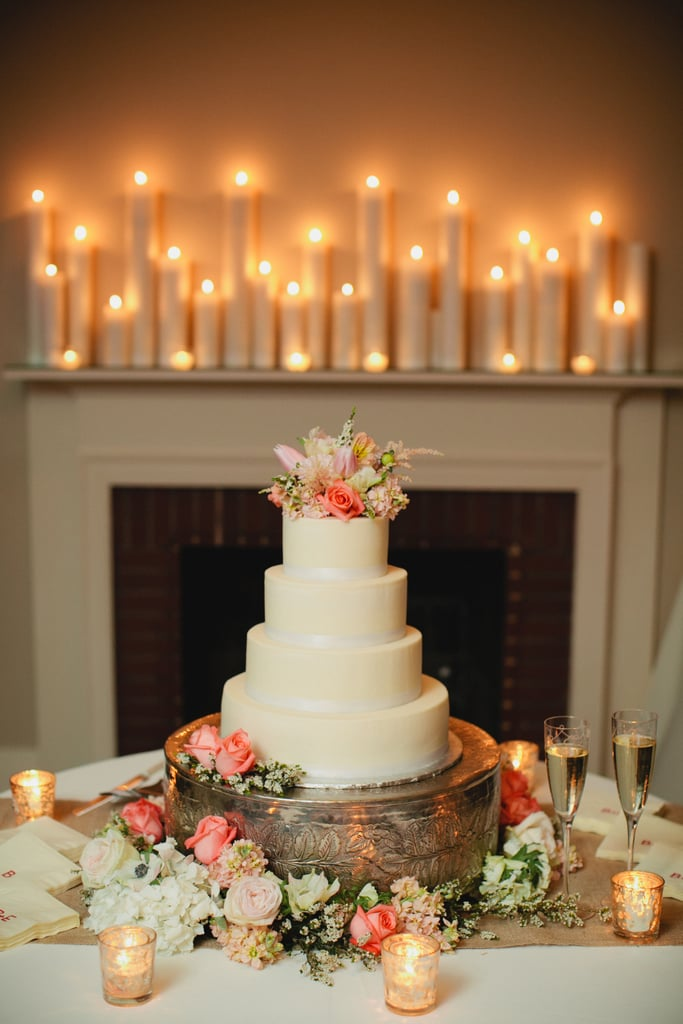 This is the perfect example of how you can take a plain tiered cake and turn it into a dessert with flair. Here, the extra details — the stand, the candles, the flowers — make it stand out, but it could just as easily look great without them.