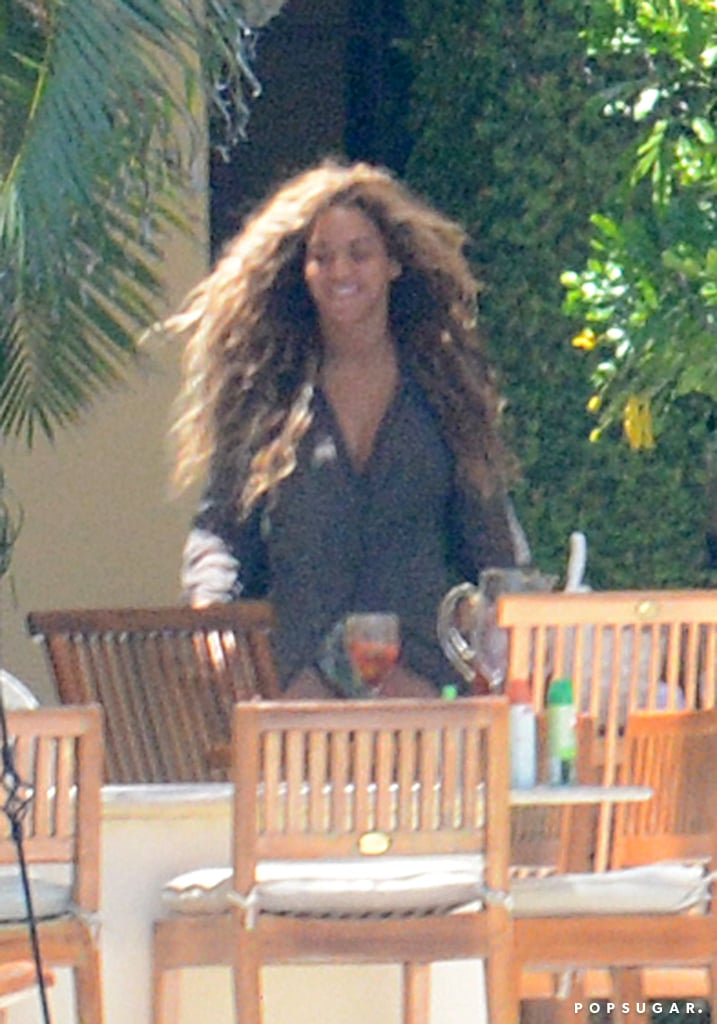Beyoncé relaxed poolside with friends and family in Miami.