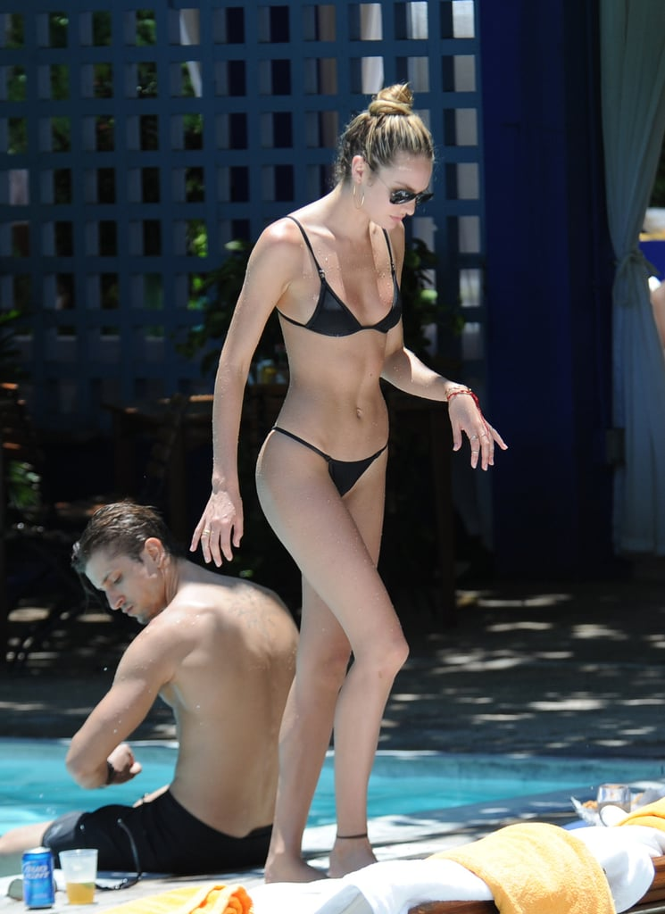 Candice Swanepoel showed off her fit figure during an afternoon poolside in Miami.