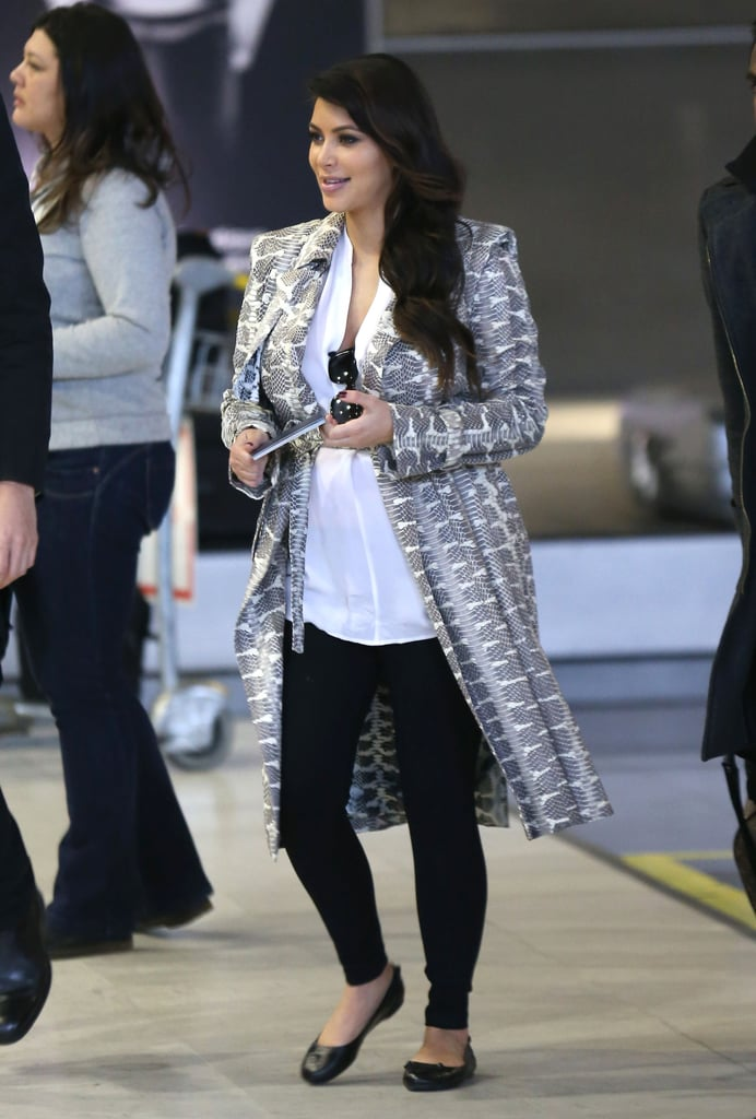Kim Kardashian wore a long gray coat.