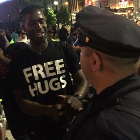 White Officer Hugs Black Man Offering Free Hugs