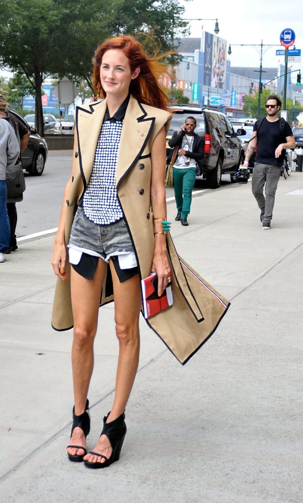 Taylor Tomasi Hill worked a bold trench, printed top, and cut-out booties with ease outside the Prabal Gurung show.