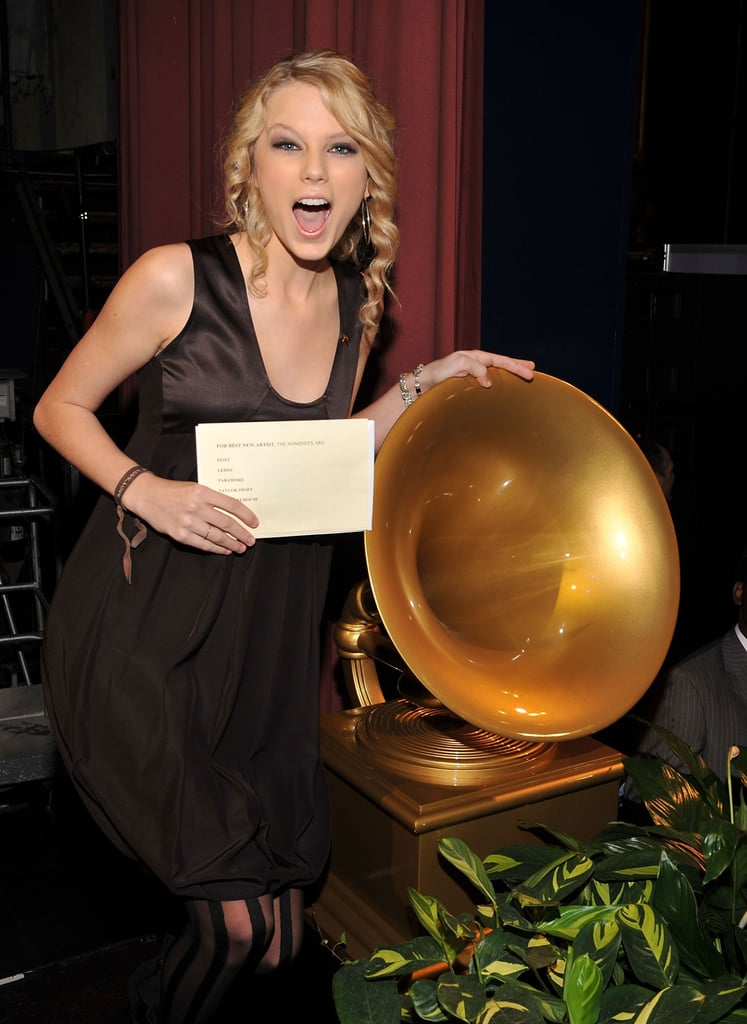 Taylor Swift posed near a Grammy statue at the nomination announcements in December 2007.