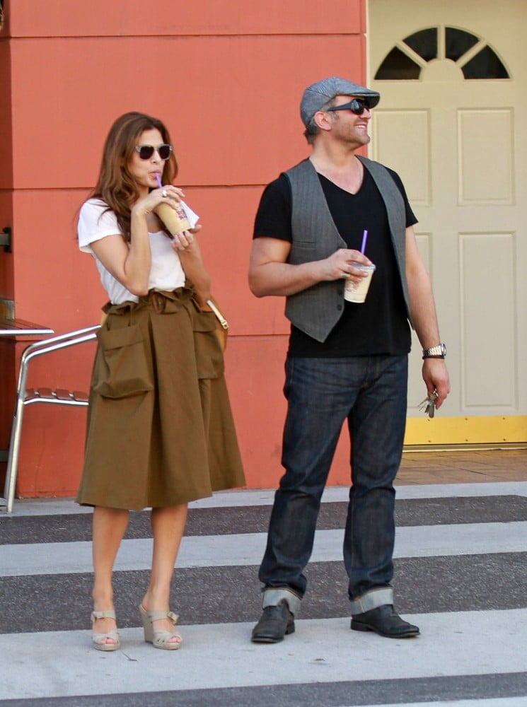 Eva Mendes offers a glimpse of how I hope to be dressing this Spring — super sweet in a paper-bag waist skirt and espadrilles.