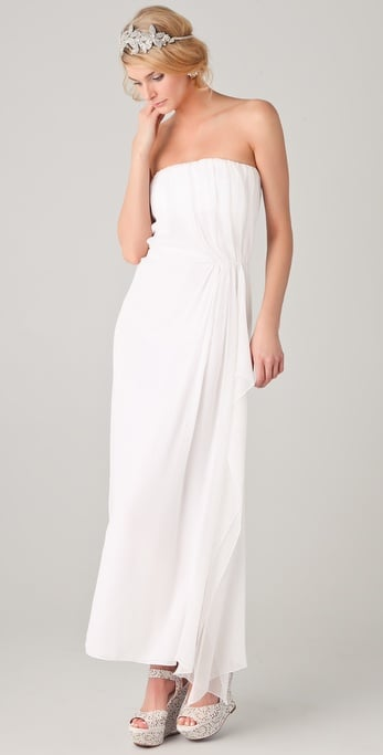 The draping at the waist is a figure-flattering detail, but the rest of the dress is relatively understated.  Alice + Olivia Ty Strapless Dress ($440)