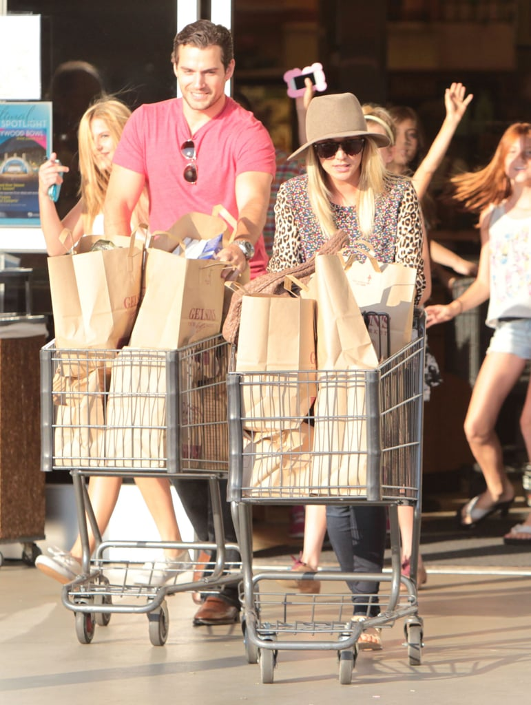 Henry Cavill and Kaley Cuoco headed to their car.