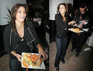 Eva Longoria Feeds the Paparazzi Outside Beso